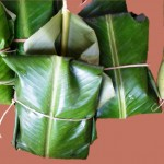 Traditional meat products ready for roasting in banana leaves